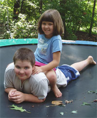 Boy with Asperger's and his sister on trampoline