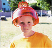 A photo of a boy with a fireman's helmet