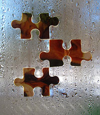 Photo of puzzle pieces on window, illustrating article on connection between sleep and GI problems in autism
