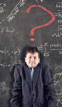 istock photo illustration of boy next to blackboard with scientific and math equations to illustrate article about understanding autism research