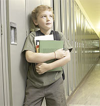 Photo of middle school boy by lockers before school starts
