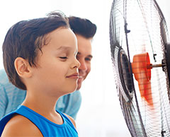 Photo of boy staring at a fan, a sensory interest in autism