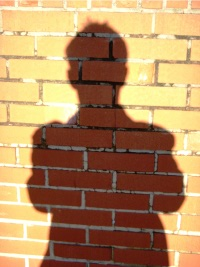 Photo of a man's shadow to illustrate transition to adulthood with autism