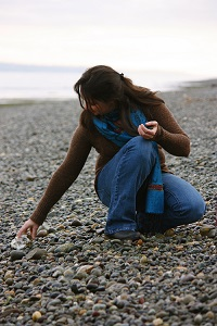 Photo of woman collecting shells