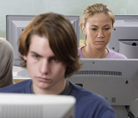 Photo of young adults working at computers