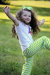 Photo of dancing girl, illustrating article about studies of children losing autism diagnosis