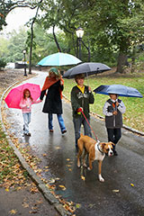 Photo of family walking in the rain, for autism article